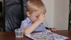 Cute little boy drawing in his album. Portrait of a small child. Stock Footage