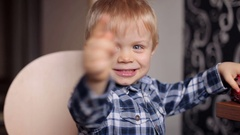 A little boy plays with toy cars at home. Portrait of a happy child. Stock Footage