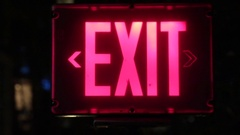 Emergency exit sign night Stock Footage