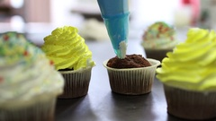 Decorating cupcake with cream. Culinary master class design cupcakes Stock Footage