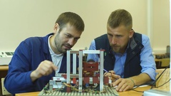 Two young engineers working on a project together in science lab Stock Footage