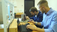 Young engineers working in the laboratory and using a computer Stock Footage
