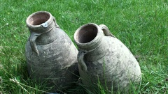 Two italian high ancient clay jug on the grass Stock Footage