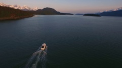 Motorboat Heading Out in Scenic Alaskan Inside Passage Aerial Sunset HD Stock Footage