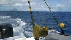 Fishing rods on sailing motor boat Stock Footage