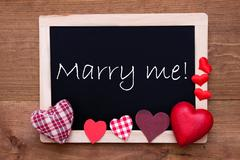 Chalkbord, Red Fabric Hearts, Text Marry Me Stock Photos