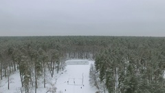 4K Aerial. Fly up  Winter   frozen lake with  people playing hockey Stock Footage