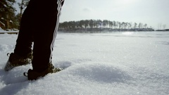 Man coming to lake at winter Stock Footage