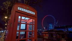 Typical for London - Telephone Booth and London Eye Stock Footage