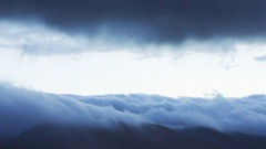 Majestic Timelapse Shot Of Clouds Rolling In Fast-Motion On Mountain Stock Footage