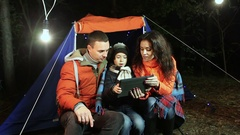 Family vacation in a pine forest. work on the tablet Stock Footage