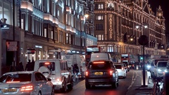 London street view at Christmas Time - Harrods Mega store at Knightsbridge Stock Footage