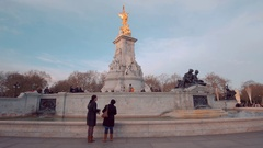 Tourists visiting the Victoria Memorial fountain at Buckingham Palace in London Stock Footage