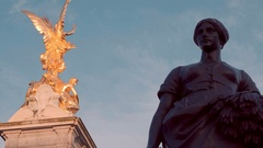 Golden statue on the top of Victoria Memorial at Buckingham Palace London Stock Footage