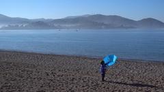 Child breaks an umbrella Stock Footage