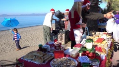 Christmas bakery sale and a child with an umbrella Stock Footage
