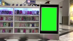 Green billboard for your ad on mobile store inside Coquitlam shopping mall Stock Footage