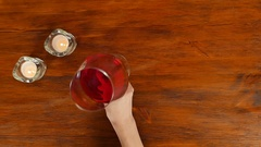 Woman testing red wine in restaurant, top view Stock Footage