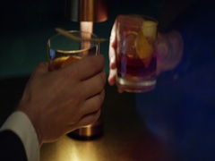 Business cheering with two glasses of whiskey Stock Footage