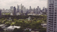 Aerial view, flying towards Lumphini Park, Bangkok Stock Footage