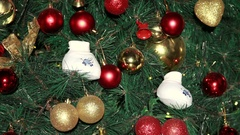 Baby booties on a Christmas tree. Stock Footage