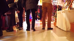4K steadicam walk though shot of customers' feet at Christmas bazar in typical Stock Footage