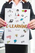 E-learning concept shown by a businesswoman Stock Photos