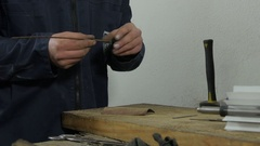 Hands of serviceman during working for the workbench by Sheyno. Stock Footage