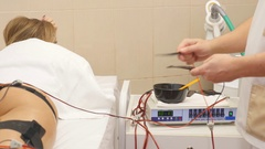 Woman getting electrical muscle stimulation in spa Stock Footage