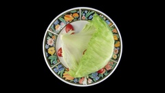Time-lapse of wilting lettuce and tomato with ALPHA channel, top Stock Footage