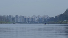 View of rowing canal with rowers against the background of buildings, 4k shot Stock Footage