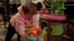 Little baby girl playing with toys at home Stock Footage