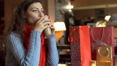 Thoughtful girl sitting in the cafe and drinking delicious coffee, steadycam  Stock Footage