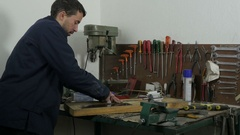 Repairman using scalpel to cutting zippers to fixing rotor,craftsman by Sheyno. Stock Footage