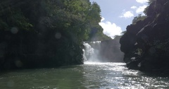 Waterfall and black volcanic rocks in Mauritius Stock Footage