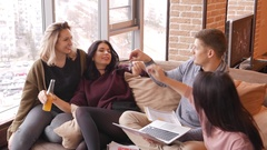 Group of multi ethnic young students having fun to preparing for exams in home Stock Footage