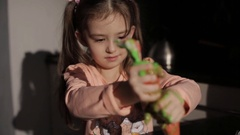 Little girl squeezes out the cream from a pastry bag. children's entertainment Stock Footage