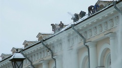 Workers remove snow from a roof. Stock Footage