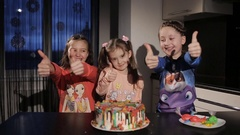 Children show a thumbs up. children the right cake. funny little girl in the Stock Footage