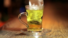 A glass of tea on a bar counter Stock Footage