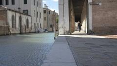 Pedestrian Walks beside Venice Canal Stock Footage