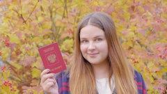 Beautiful woman with russian passport Stock Footage