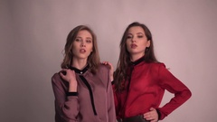 Two girls Models posing for Fashion Photo Session Studio Stock Footage