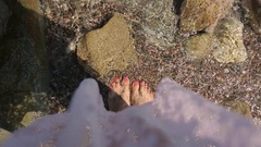 Woman walking at a beach in summer (POV perspective) Stock Footage