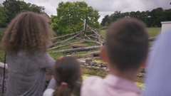 4K Happy family looking into animal enclosure at the zoo Stock Footage