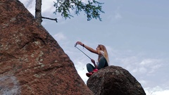 Girl taking selfie using smartphone in mountains Stock Footage