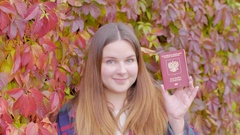 Beautiful woman with two russian passports Stock Footage