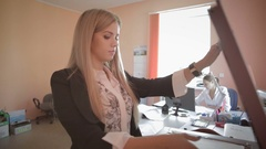 Beautiful young business woman making photocopies in office stock footage video Stock Footage