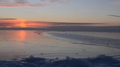 Sunset over the freezing sea Stock Footage