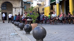 Tourists in the open air restaurant at the Plaza Vieja. Old Havana, Cuba. Stock Footage